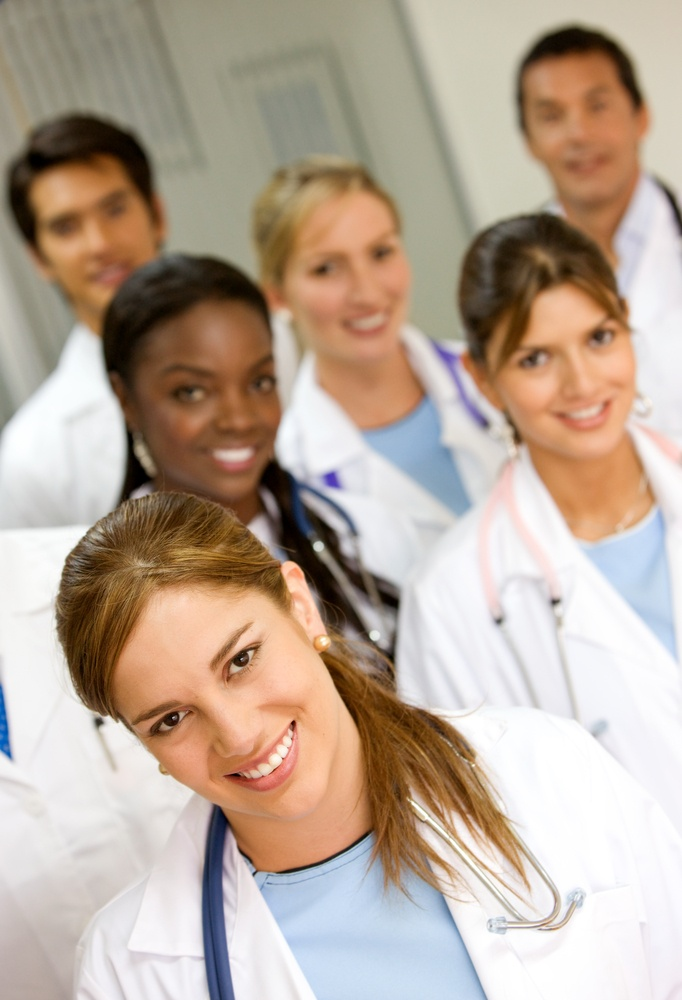 group of doctors in a hospital smiling